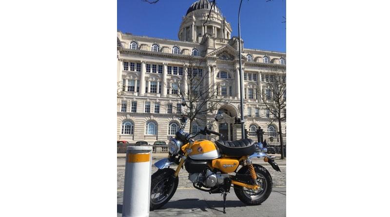 Honda Monkey bike with motorhome monkey at Liverpool Pier Head.
