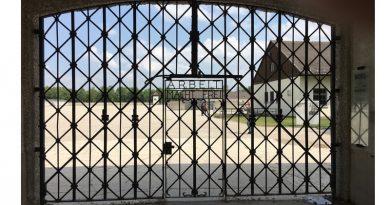 Gates inscribed with Arbeit Macht Frei
